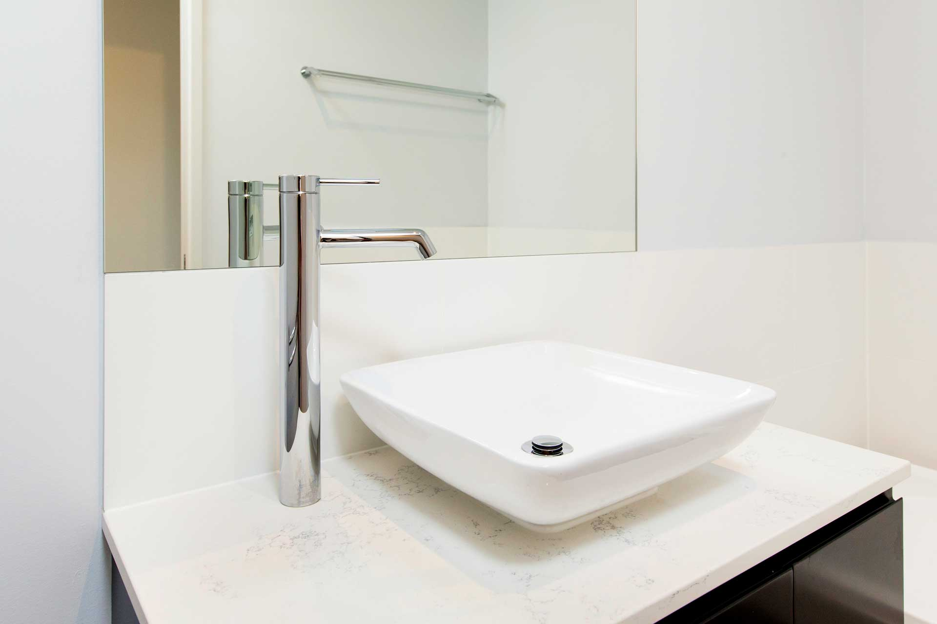 close up image of felucca bathroom basin and mirror