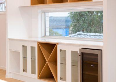 Custom bar cabinetry and wine racks